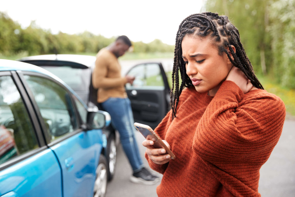 woman-inured-on-phone-in-car-accident
